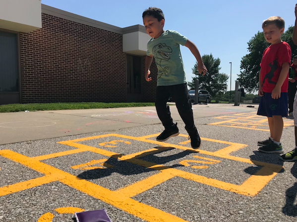 Students laying hopscotch